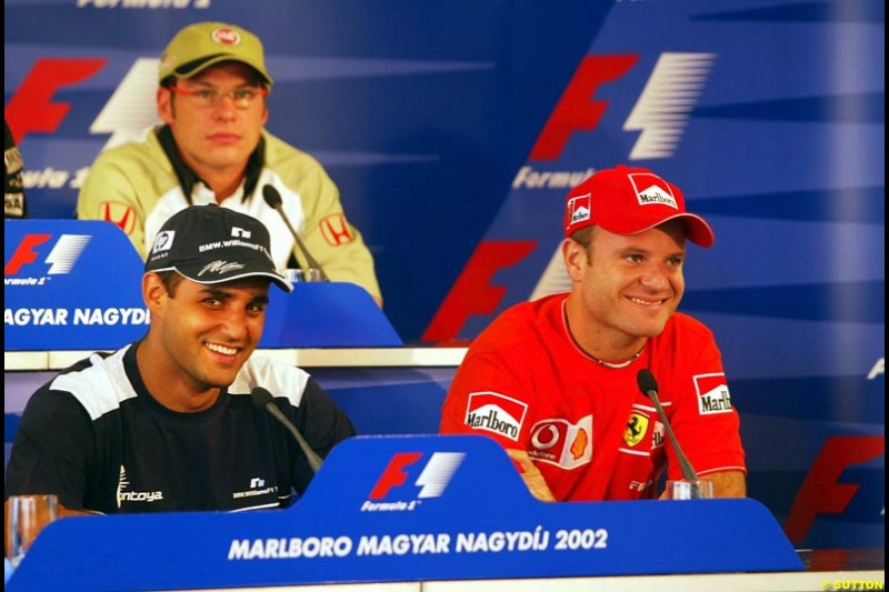 Good friends Rubens Barrichello, Ferrari, and Juan Pablo Montoya, Williams, share a joke during the FIA Thursday Press Conference. Hungarian Grand Prix, Budapest, Hungary, August 15th 2002.