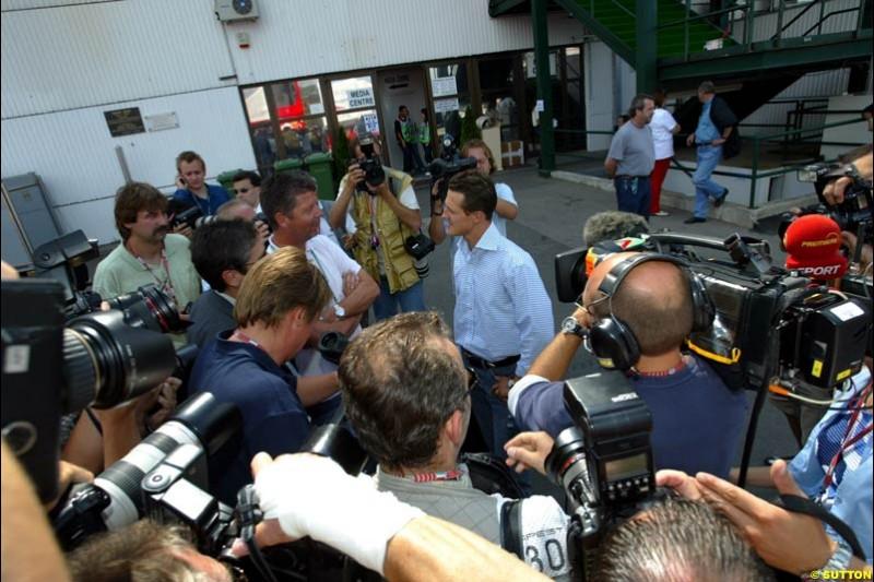 Michael Schumacher, Ferrari, talks to the press. Hungarian Grand Prix, Budapest, Hungary, August 15th 2002.