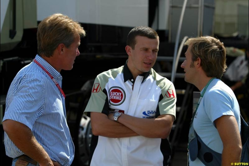 Craig Pollock chats to Olivier Panis and Patrick Lemarie, both of British American Racing, in the paddock. Hungarian Grand Prix, Budapest, Hungary, August 15th 2002.