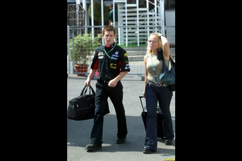 Anthony Davidson, Minardi, arrives with girlfriend Johanne Taskinen. Hungarian Grand Prix, Budapest, Hungary, August 15th 2002.