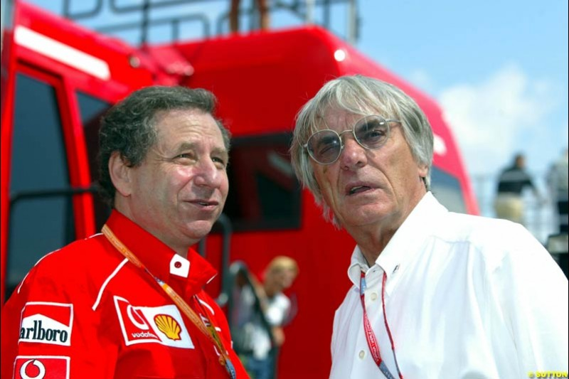 Jean Todt, Ferrari Director, chats to Bernie Ecclestone, F1 Supremo, during Qualifying, Hungarian Grand Prix, Budapest, August 17 2002.
