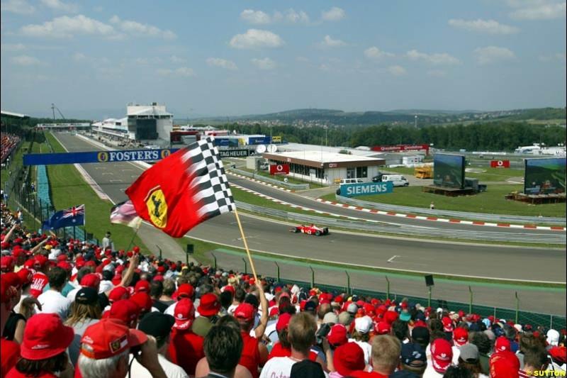 The fans watch Michael Schumacher, Ferrari, during Qualifying, Hungarian Grand Prix, Budapest, August 17 2002.