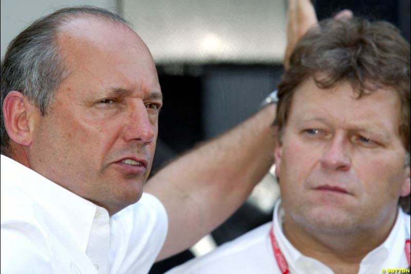 Ron Dennis, McLaren Team Owner, with Norbert Haug, Mercedes Sporting Director, during Qualifying, Hungarian Grand Prix, Budapest, August 17 2002.
