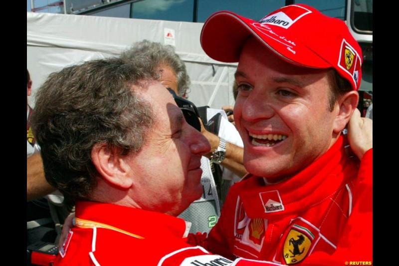 Rubens Barrichello, Ferrari, celebrates his third pole of the season with Ferrari Director Jean Todt. Hungarian Grand Prix, Budapest, August 17 2002.