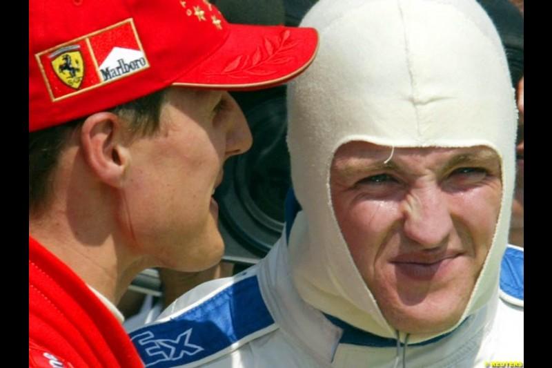 Michael Schumacher (2nd), Ferrari, talks to Ralf Schumacher (3rd), Williams, after qualifying. Hungarian Grand Prix, Budapest, August 17 2002.