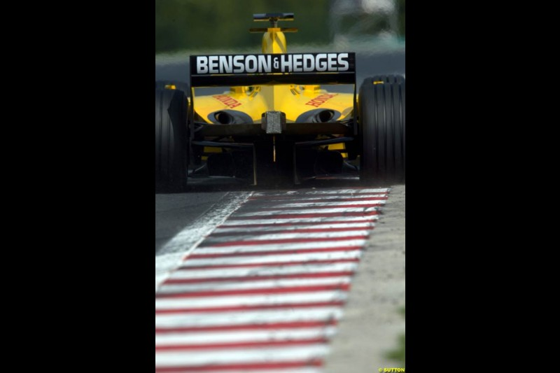 A Jordan rides the curb, during Saturday free practice, Hungarian Grand Prix, Budapest, August 17 2002.