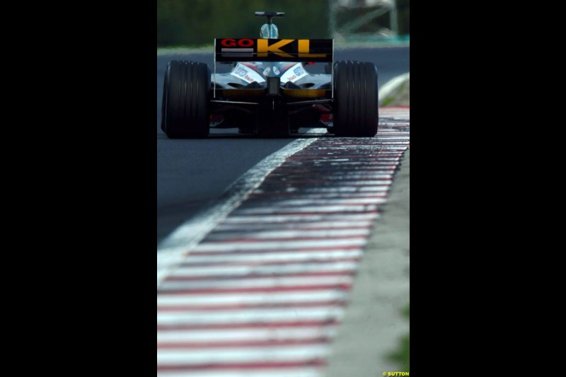 A Minardi rides the curb, during Saturday free practice, Hungarian Grand Prix, Budapest, August 17 2002.