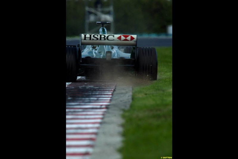 A Jaguar rides the curb, during Saturday free practice, Hungarian Grand Prix, Budapest, August 17 2002.