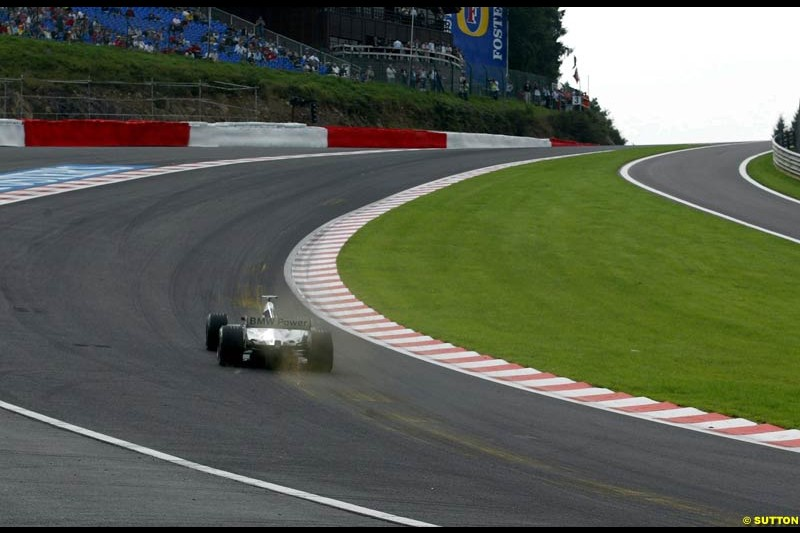 A Williams takes Eau Rouge during Saturday Free Practice. Belgian Grand Prix, Spa-Francorchamps, Belgium, August 31st 2002.