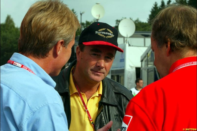 Former World Champion Nigel Mansell in the paddock. Belgian Grand Prix, Spa-Francorchamps, Belgium, August 31st 2002.