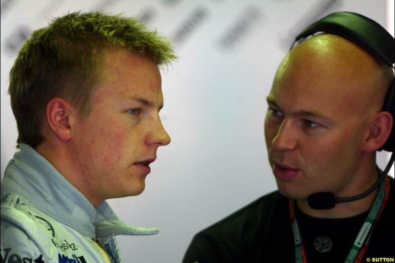 Kimi Raikkonen chats to his fitness advisor during Saturday Free Practice. Belgian Grand Prix, Spa-Francorchamps, Belgium, August 31st 2002.