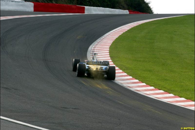 A Renault, takes Eau Rouge during Saturday Free Practice. Belgian Grand Prix, Spa-Francorchamps, Belgium, August 31st 2002.