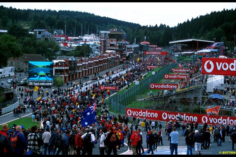 Fans stream down Eau Rouge at the end of the race. Belgian Grand Prix, Spa-Francorchamps, Belgium, September 1st 2002.