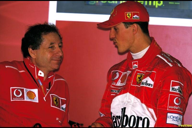 Jean Todt, Ferrari Director, chats to Michael Schumacher. Belgian Grand Prix, Spa-Francorchamps, Belgium, September 1st 2002.