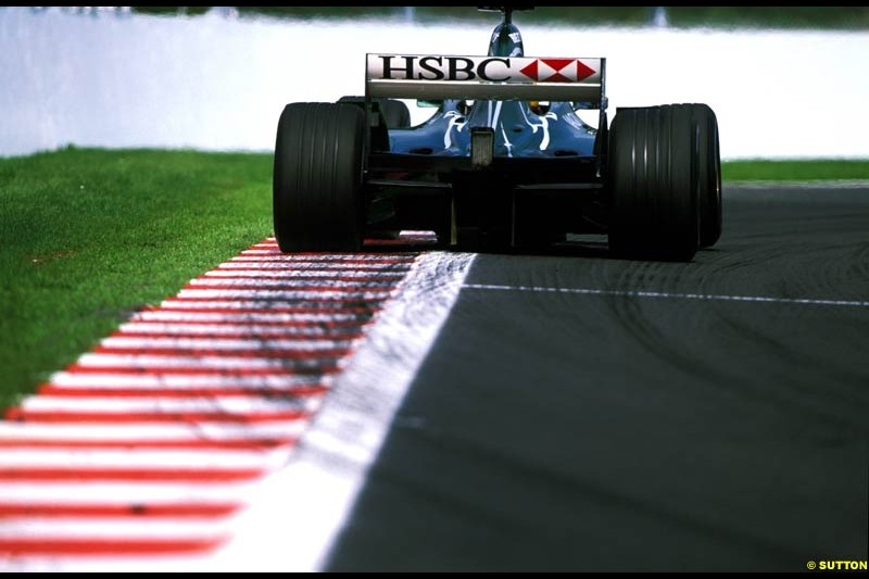 A Jaguar rides the curb. Belgian Grand Prix, Spa-Francorchamps, Belgium, September 1st 2002.