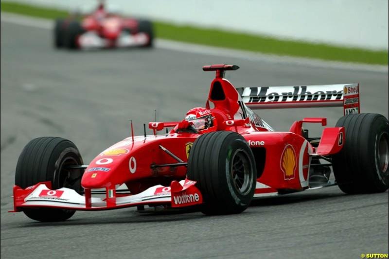 Michael Schumacher, Ferrari, leads team mate Rubens Barrichello. Belgian Grand Prix, Spa-Francorchamps, Belgium, September 1st 2002.