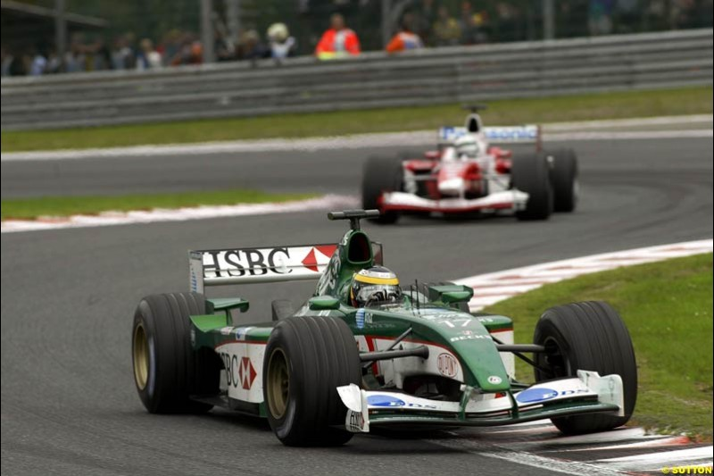 Pedro de la Rosa, Jaguar, leads a Toyota. Belgian Grand Prix, Spa-Francorchamps, Belgium, September 1st 2002.
