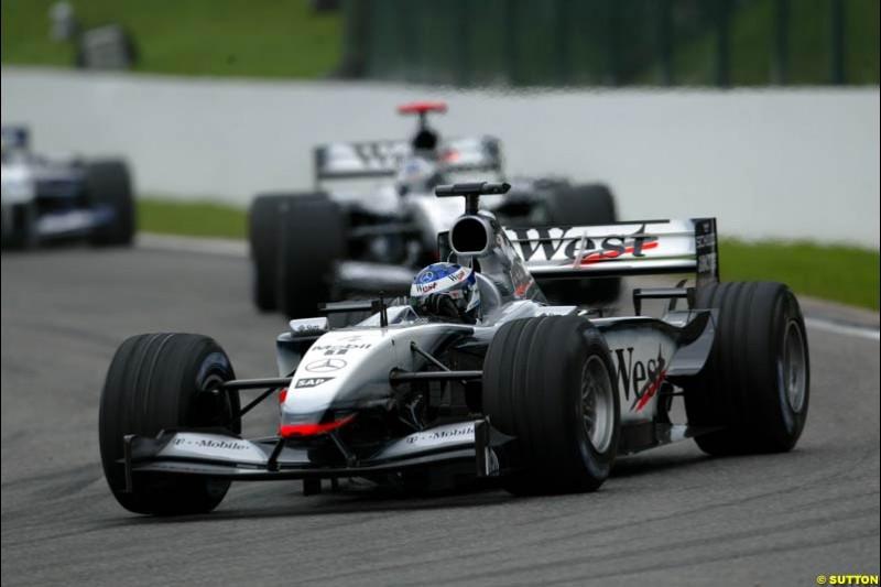 Kimi Raikkonen, McLaren, leads team mate David Coulthard. Belgian Grand Prix, Spa-Francorchamps, Belgium, September 1st 2002.