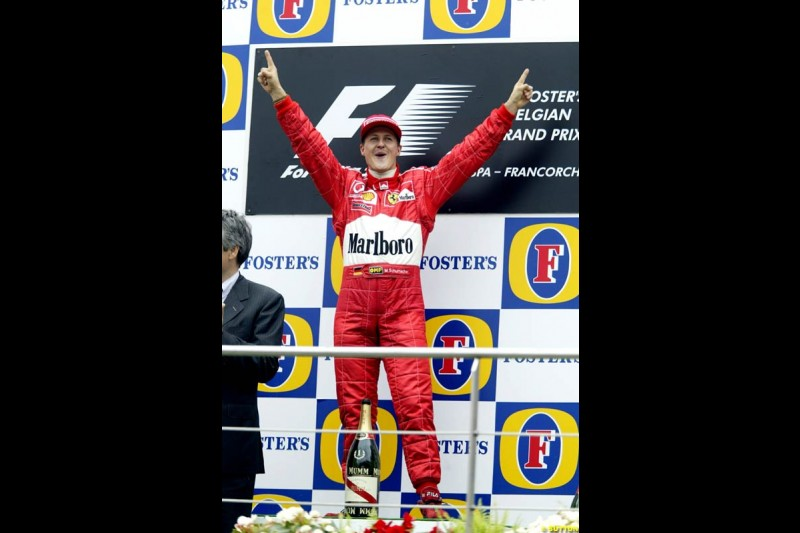 Michael Schumacher, Ferrari, celebrates victory. Belgian Grand Prix, Spa-Francorchamps, Belgium, September 1st 2002.