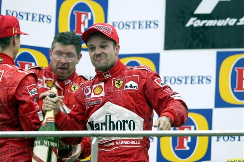 Michael Schumacher, Ross Brawn, and Rubens Barrichello of Ferrari celebrate. Belgian Grand Prix, Spa-Francorchamps, Belgium, September 1st 2002.