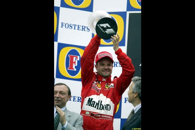 Rubens Barrichello, Ferrari, celebrates second on the podium. Belgian Grand Prix, Spa-Francorchamps, Belgium, September 1st 2002.