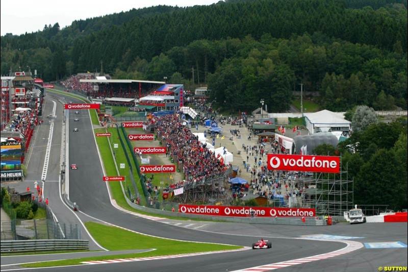 Michael Schumacher, Ferrari, leads from the start. Belgian Grand Prix, Spa-Francorchamps, Belgium, September 1st 2002.