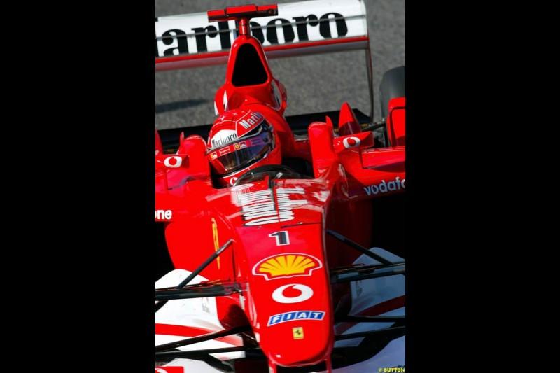 Michael Schumacher, Ferrari, during Sunday Warmup. Belgian Grand Prix, Spa-Francorchamps, Belgium, September 1st 2002.