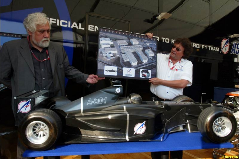 John Gano, Asiatech President and Enrique Scalabroni, Asiatech engine designer, unveil a model of the proposed 2004 Asiatech Formula 1 car. Italian Grand Prix, Monza, Italy. September 14th 2002.