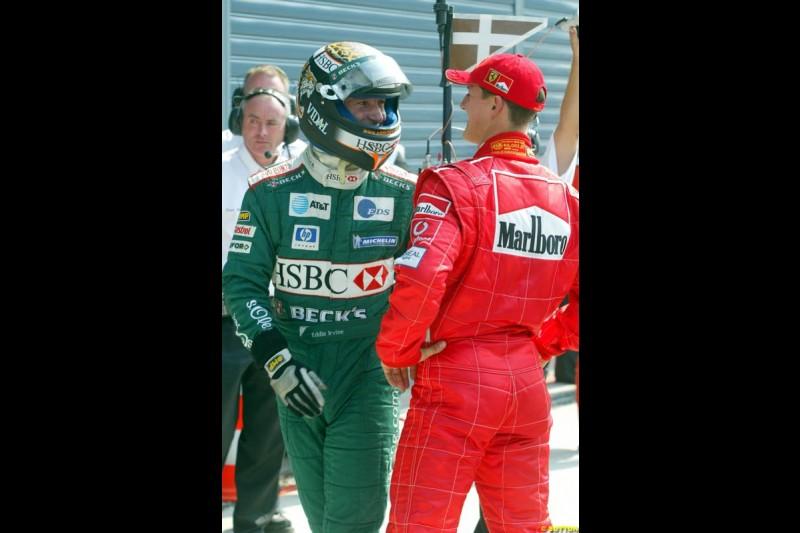 Eddie Irvine, Jaguar, with Michael Schumacher, Ferrari. Italian Grand Prix, Monza, Italy. September 14th 2002.