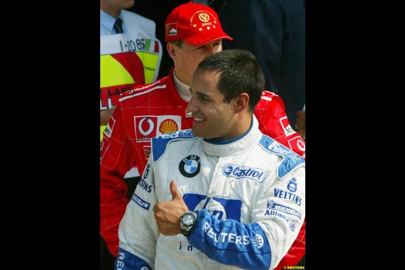 Juan Pablo Montoya, Williams, celebrates Pole. Italian Grand Prix, Monza, Italy. September 14th 2002.