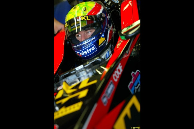 Mark Webber, Minardi, sits in his cockpit during Saturday Free Practice. Italian Grand Prix, Monza, Italy. September 14th 2002.