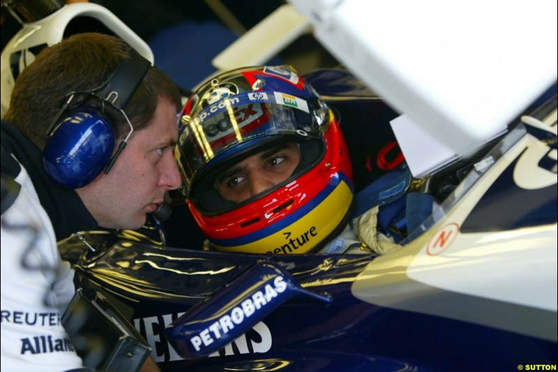 Juan Pablo Montoya chats to a Williams Engineer during Saturday Free Practice. Italian Grand Prix, Monza, Italy. September 14th 2002.
