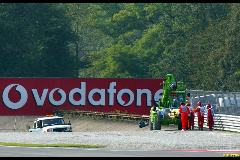 Marshals work to recover the stranded car of Jenson Button during Saturday Free Practice. Italian Grand Prix, Monza, Italy. September 14th 2002.