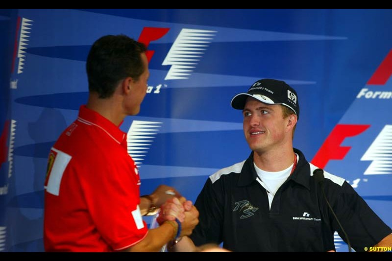 Ralf and Michael Schumacher at the FIA Friday's Press Conference. United States GP, Indianapolis, September 27th 2002.