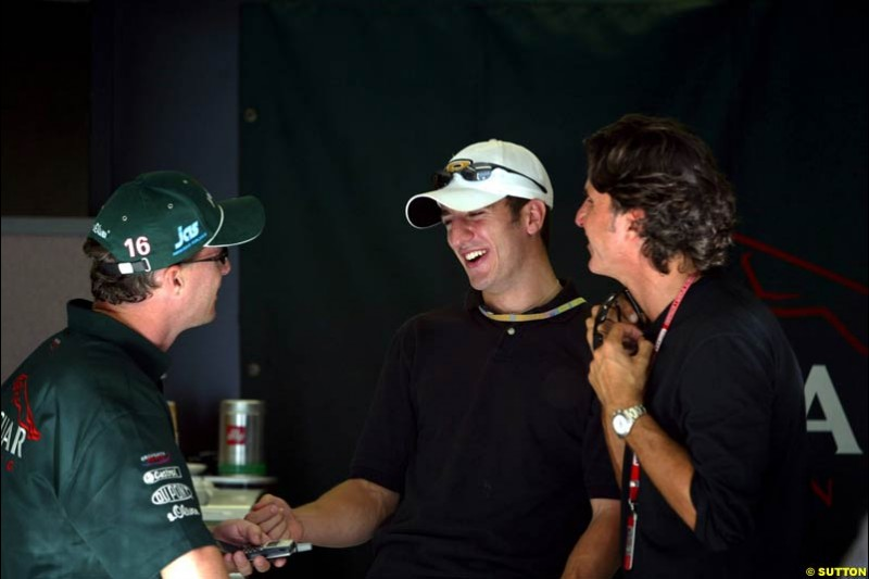 Eddie Irvine with Tomas Scheckter and their manager. Friday Free Practice, United States GP, Indianapolis, September 27th 2002.