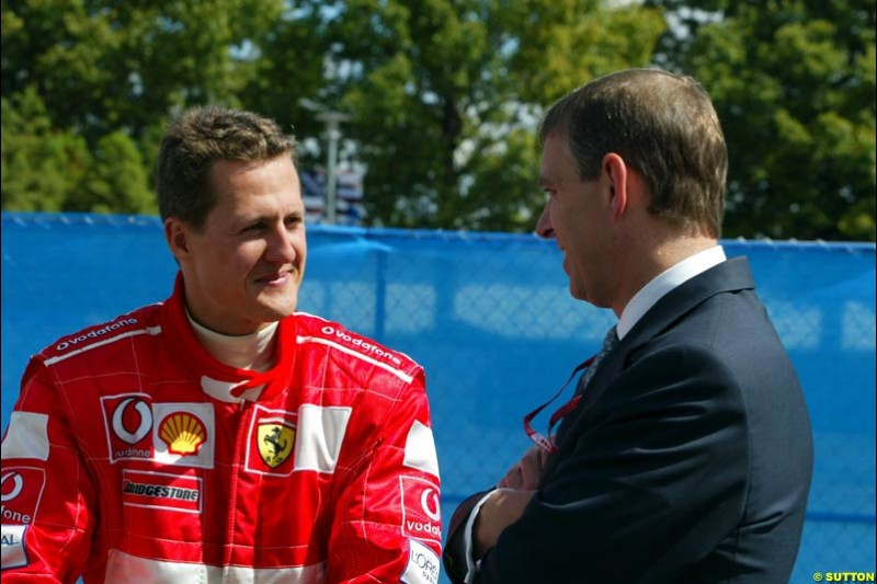 Michael Schumacher, Ferrari, and the Duke of York. Friday Free Practice, United States GP, Indianapolis, September 27th 2002.