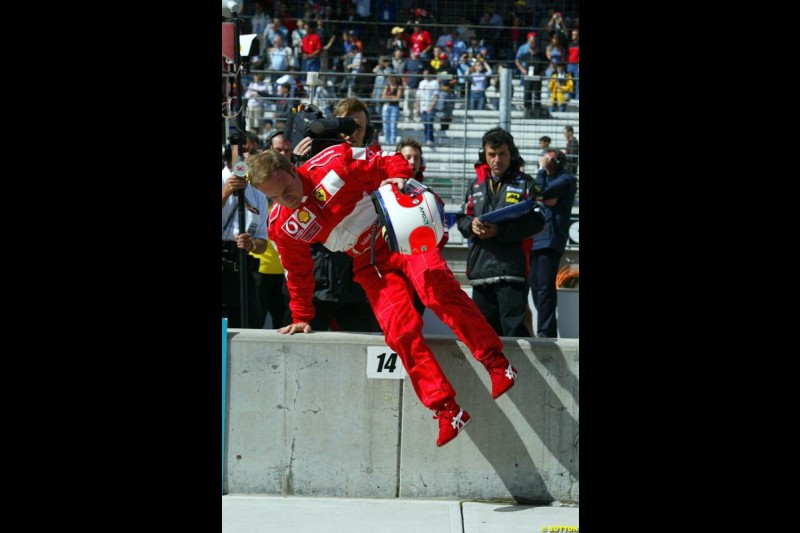 Rubens Barrichello, Ferrari, returns to the pits. Friday Free Practice, United States GP, Indianapolis, September 27th 2002.