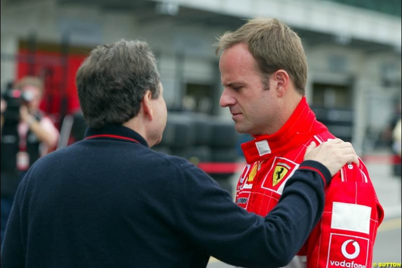 Ferrari's Jean Todt and Rubens Barrichello at the Indianapolis Motor Speedway, United States GP, Indianapolis, September 26th 2002.