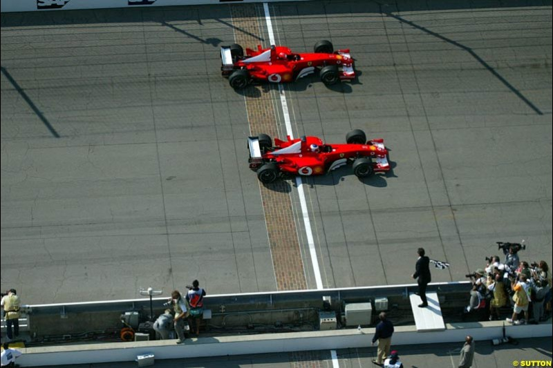 Rubens Barrichello (BRA, below) Ferrari F2002 inches past team mate Michael Schumacher (GER) Ferrari F2002 to take an unexpected victory. United States Grand Prix Race, Indianapolis, 29 September 2002