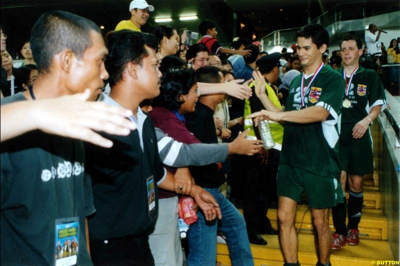 Alex Yoong takes part in a charity football match with Irish boy band Westlife. Malaysia, Kuala Lumpur, 30 October 2002.
