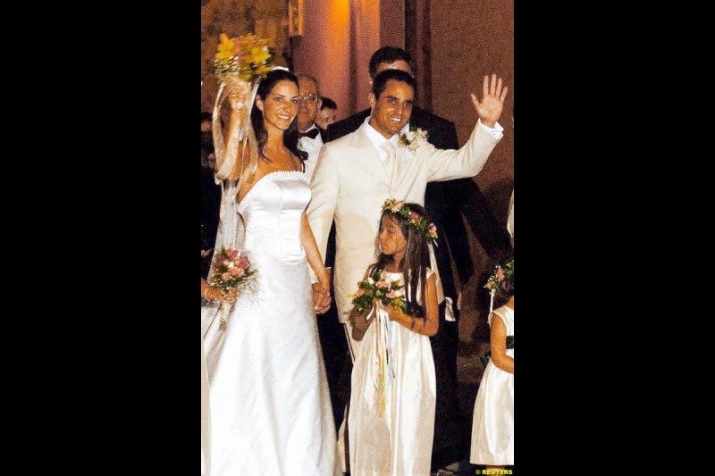 Juan Pablo Montoya and his new wife Connie Freydell leave San Toribio church in Cartagena, Bolivar province, after their wedding, October 26, 2002.