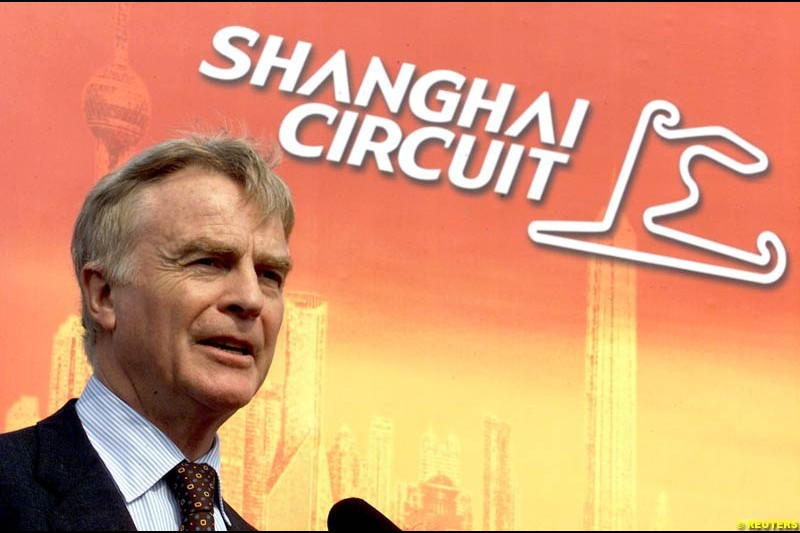 Max Mosley, president of the FIA, delivers a speech during the Shanghai Circuit's ground-breaking ceremony October 17, 2002.