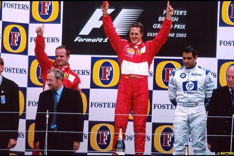 British Grand Prix, Round 10 Podium. 1-Michael Schumacher, Ferrari. 2-Rubens Barrichello, Ferrari. 3-Juan Pablo Montoya, Williams.