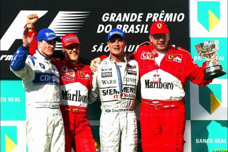Brazilian Grand Prix, Round 3 Podium. 1-Michael Schumacher, Ferrari. 2-Ralf Schumacher, Williams. 3-David Coulthard, McLaren.