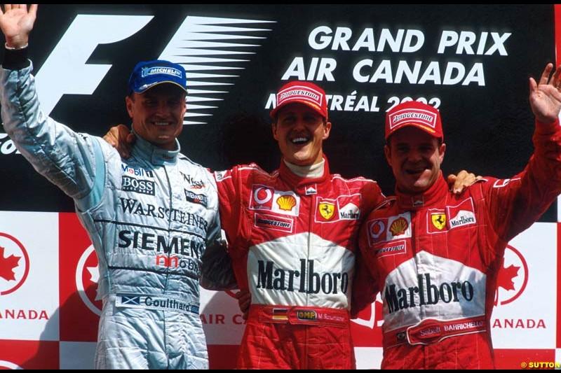 Canadian Grand Prix, Round 8 Podium. 1-Michael Schumacher, Ferrari. 2-Rubens Barrichello, Ferrari. 3-David Coulthard, McLaren.