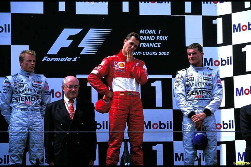 French Grand Prix, Round 11 Podium. 1-Michael Schumacher, Ferrari. 2-Kimi Raikkonen, McLaren. 3-David Coulthard, McLaren.
