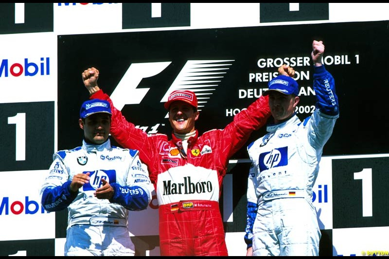 German Grand Prix, Round 12 Podium. 1-Michael Schumacher, Ferrari. 2-Ralf Schumacher, Williams. 3-Juan Pablo Montoya, Williams.