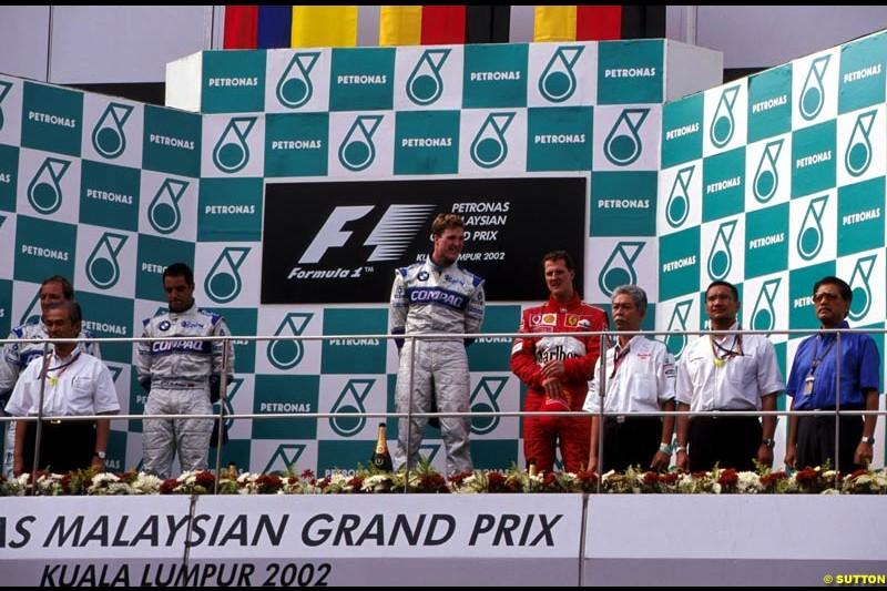 Malaysian Grand Prix, Round 9 Podium. 1-Ralf Schumacher, Williams. 2-Juan Pablo Montoya, Williams. 3-Michael Schumacher, Ferrari.