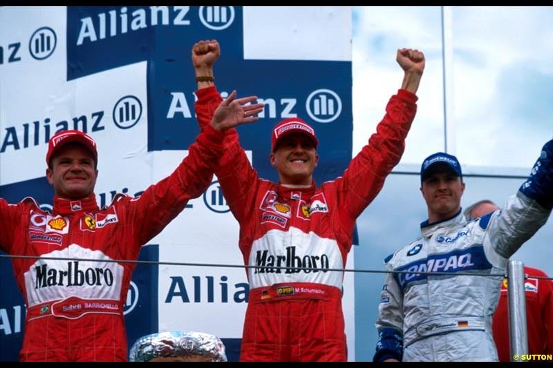 San Marino Grand Prix, Round 4 Podium. 1-Michael Schumacher, Ferrari. 2-Rubens Barrichello, Ferrari. 3-Ralf Schumacher, Williams.