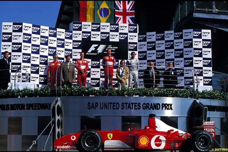 US Grand Prix, Round 16 Podium. 1-Rubens Barrichello, Ferrari. 2-Michael Schumacher, Ferrari. 3-David Coulthard, McLaren.